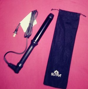 Sutra clipless curling iron.